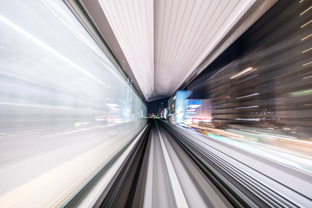 Motion blur of train moving inside tunnel with  light in tokyo, Japan. Banco de Imagens - 115219003