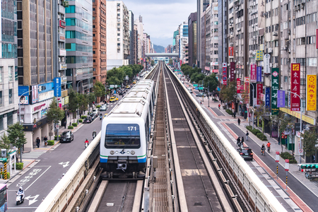 Taipei, Taiwan - January 27, 2019 : Taipei Metro Wenhu Line (Known as The Muzha Line Before Oct, 8, 2009). The Train Runs on Elevated Rails While Other Cars Jammed on The Roads.