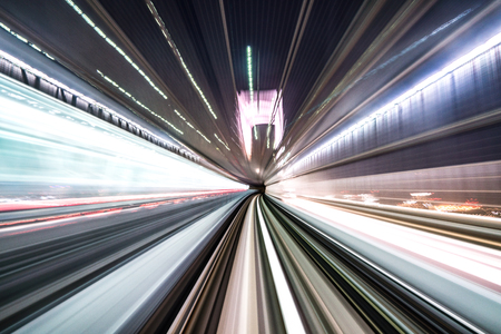 Motion blur of train moving inside tunnel with daylight in tokyo, Japan. Banco de Imagens - 118113536