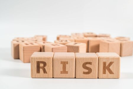 RISK wooden blocks of business concept isolated on white background.