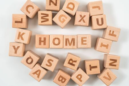 word HOME on wood cube dices on white background.