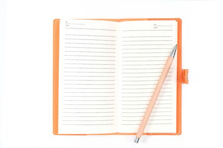 top view blank orange leather diary and pencil on white desk Foto de archivo