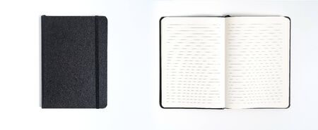 Notebook mock up with clean black blank for design and advertising. Notepad with chromed spring and free copy space template. On the gray background.