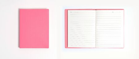 Pink notebook on white desk. Business minimal concept for women. Flat lay, top view, copy space