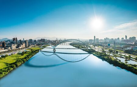 Crescent Bridge - landmark of New Taipei, Taiwan with beautiful illumination at day, aerial photography in New Taipei, Taiwan. 版權商用圖片