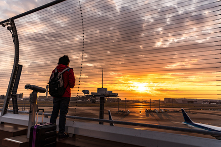 People silhouette outside Observation Deck. Tokyo International Airport at sunrise  sunset panorama, Haneda Airport in Tokyo, Japan.