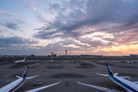 Tokyo, Japan - March 25, 2019. Tokyo International Airport at sunrise / sunset panorama, Haneda Airport in Tokyo, Japan. Stock Photo - 129869146