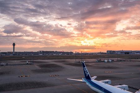 Tokyo, Japan - March 25, 2019. Tokyo International Airport at sunrise  sunset panorama, Haneda Airport in Tokyo, Japan. Editorial