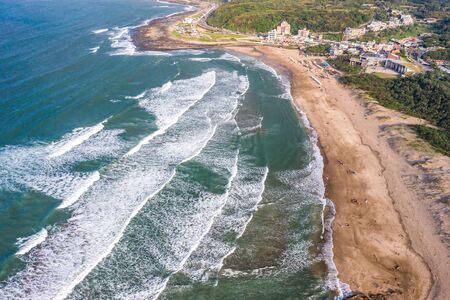 Aerial view of sandy beach with tourists swimming in beautiful clear sea water Фото со стока - 131854676