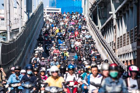 Taipei, Taiwan - September 25, 2019: Motorcycles go down the Taipei bridge during rush hour in the morning. Editorial