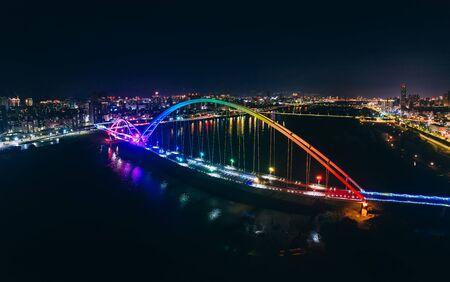 Crescent Bridge - landmark of New Taipei, Taiwan with beautiful illumination at night, photography in New Taipei, Taiwan.