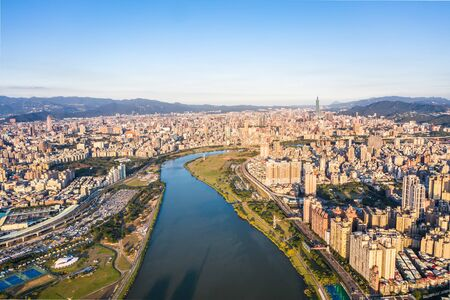 Taipei City Aerial View - Asia business concept image, panoramic modern cityscape building bird's eye view under daytime and blue sky, shot in Taipei, Taiwan. Standard-Bild