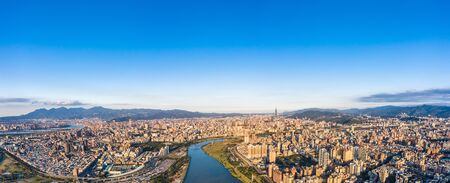 Taipei City Aerial View - Asia business concept image, panoramic modern cityscape building bird's eye view under daytime and blue sky, shot in Taipei, Taiwan. 版權商用圖片