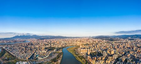 Taipei City Aerial View - Asia business concept image, panoramic modern cityscape building bird's eye view under daytime and blue sky, shot in Taipei, Taiwan. Stock Photo