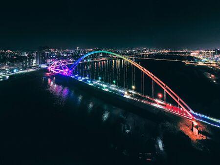 Crescent Bridge - landmark of New Taipei, Taiwan with beautiful illumination at night, photography in New Taipei, Taiwan. Imagens