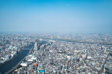Asia business concept for real estate and corporate construction - panoramic urban city skyline aerial view under sky in tokyo, Japan