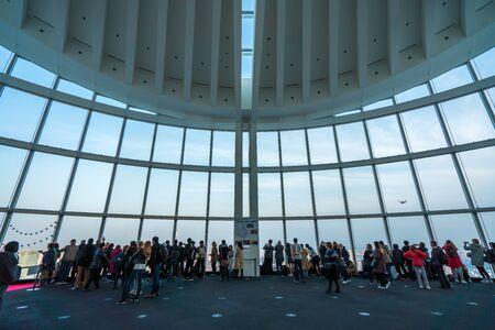 TOKYO, JAPAN - March 27, 2019: People silhouette inside Observation Deck. Tokyo, Japan.