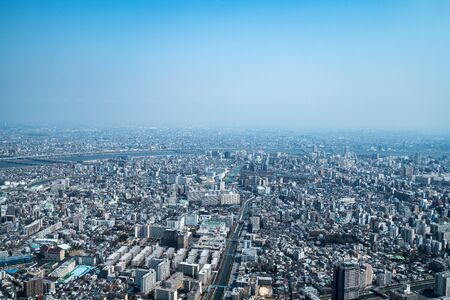 Asia business concept for real estate and corporate construction - panoramic urban city skyline aerial view under sky in tokyo, Japan 版權商用圖片 - 138045169