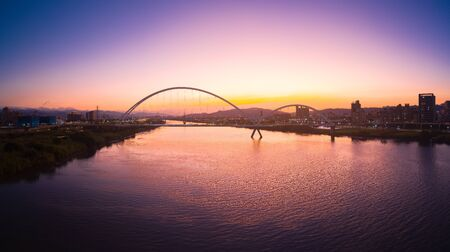 Crescent Bridge - landmark of New Taipei, Taiwan with beautiful illumination at day, aerial photography in New Taipei, Taiwan. Stock Photo