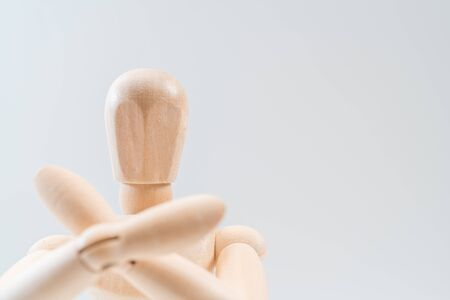 Refusal gesture, Wooden dummy, crossed hands on white background, copy space for your object or text Standard-Bild