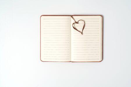 top view blank orange leather diary on white desk