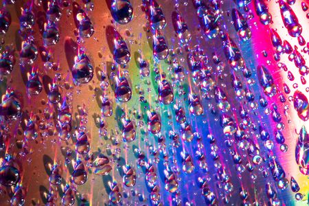 water drops on dvd media, water drops on colorful background