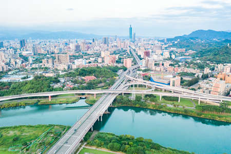 Taipei City Aerial View-Asia business concept image, panoramic modern cityscape building bird's eye view under sunrise and morning blue bright sky, shot in Taipei, Taiwan Stockfoto