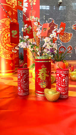 The traditional Chinese golden firecrackers are used to scare away bad luck. They protect and bring security to your home. (Translation: Good luck and spring) Stock Photo