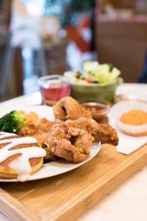 Classic USA breakfast. fried chicken, pancakes waffles, fried eggs.