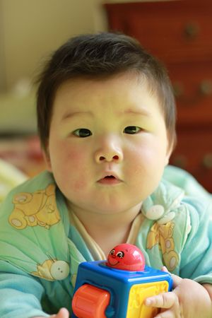 lovely chinese baby playing toy
