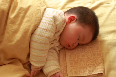 months: sleeping child Stock Photo