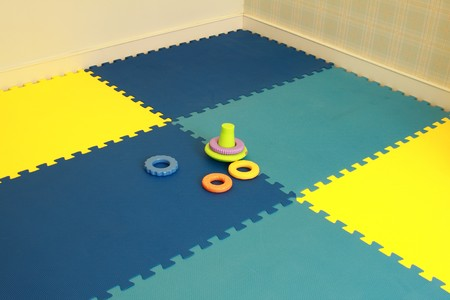 Baby playing carpet Stock Photo