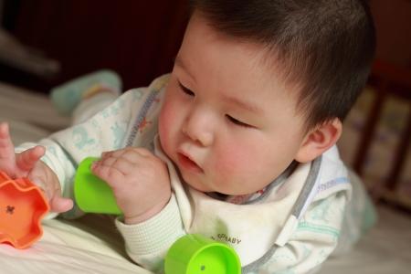 kid playing toys photo