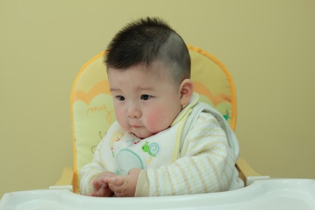 baby sitting on a chair Stock Photo - 7234532