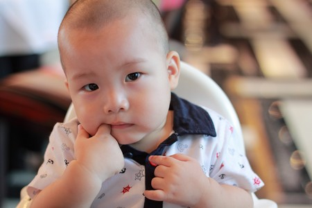 Asian boy sucking finger Stock Photo