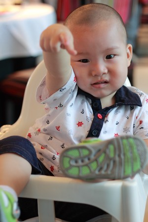 cute kid pointing Stock Photo - 7913124