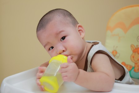 baby drinking water photo
