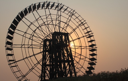 Waterwheel sunset photo