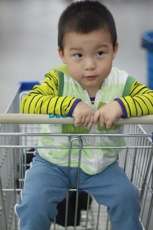 kid in the supermarket photo