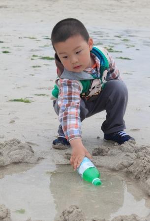 kid play in the beach photo