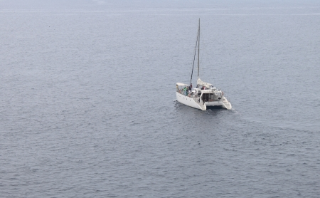 yacht sailing in the sea photo