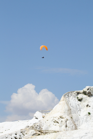 Paragliding over over mountain in cotton castle pamukkale turkey