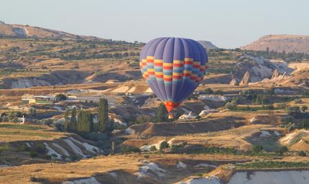 hot air ballon over the cappadocia mountain under sunlight