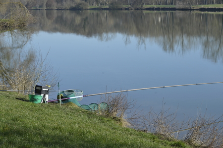 fishing rod on the edge of the pond Stock fotó