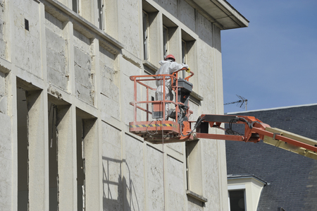 masons workers in basket 写真素材
