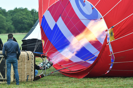 inflating a hot air balloon 写真素材