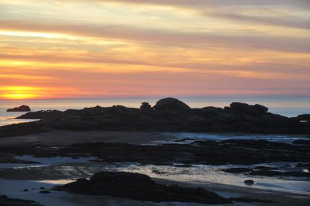 sunset on the rocky coast of Tregastel-France