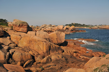rocky coast of pink granite of Tregastel in Brittany