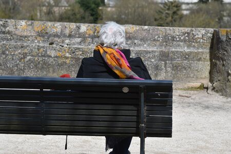 loneliness of a senior on a bench
