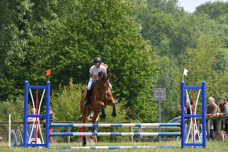 jumping in a horse show Stockfoto - 129583707